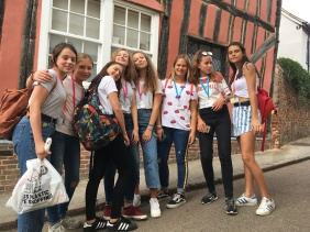 The girls strike a pose in front of Lavenham's historic buildings.